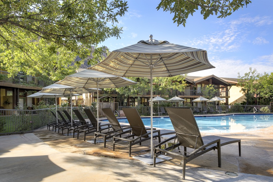 Lounge chairs and umbrellas around pool