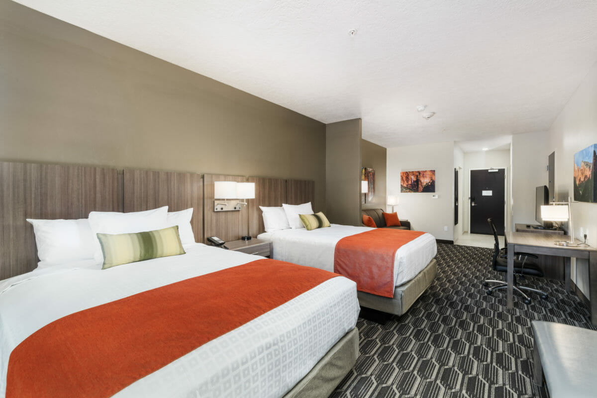 Modern hotel room with two queen beds