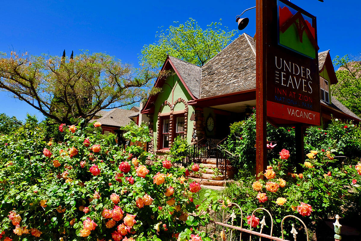 Historic bed and breakfast building surrounded by rose bushes