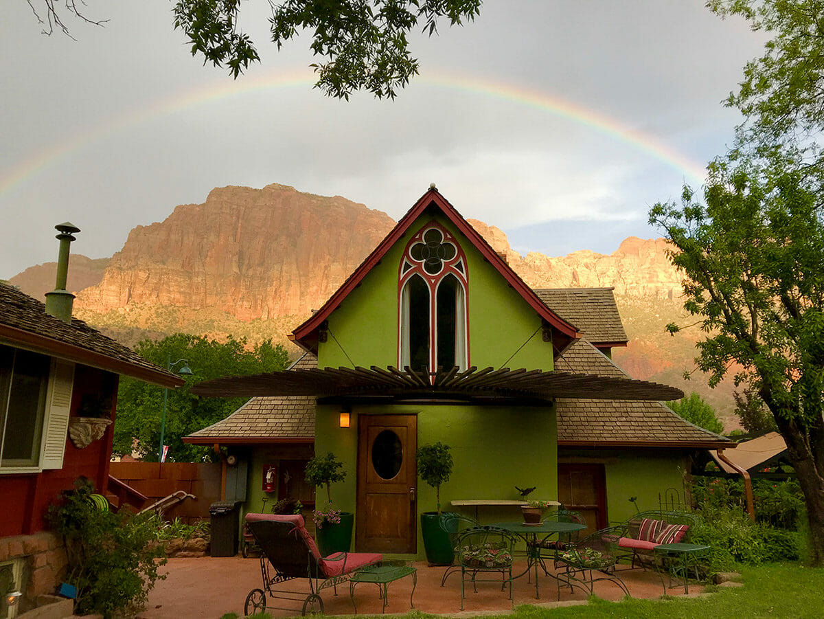View of historic house with rainbow