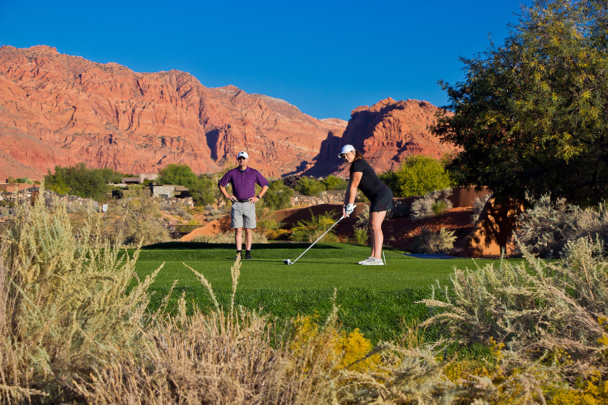 Couple golfing on desert course