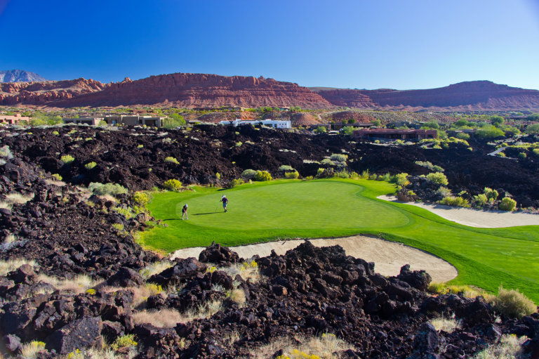 Golf course surrounded by black lava rocks