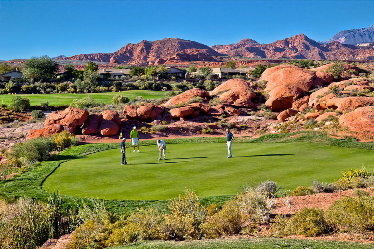 Foursome on the green at desert golf course
