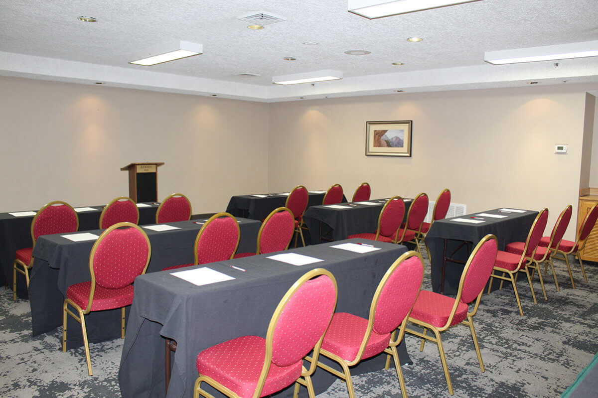 Tables and chairs set up for conference in hotel