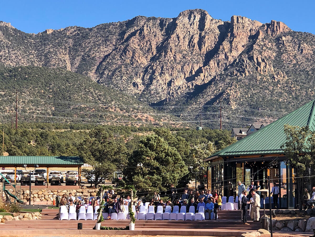 Mountains looming over outdoor event setting
