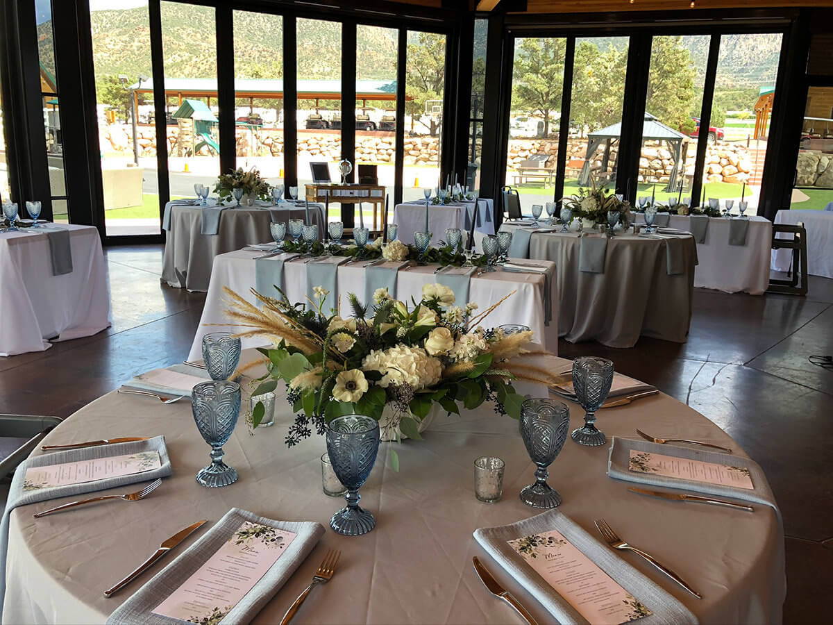 Banquet tables with menus and place settings