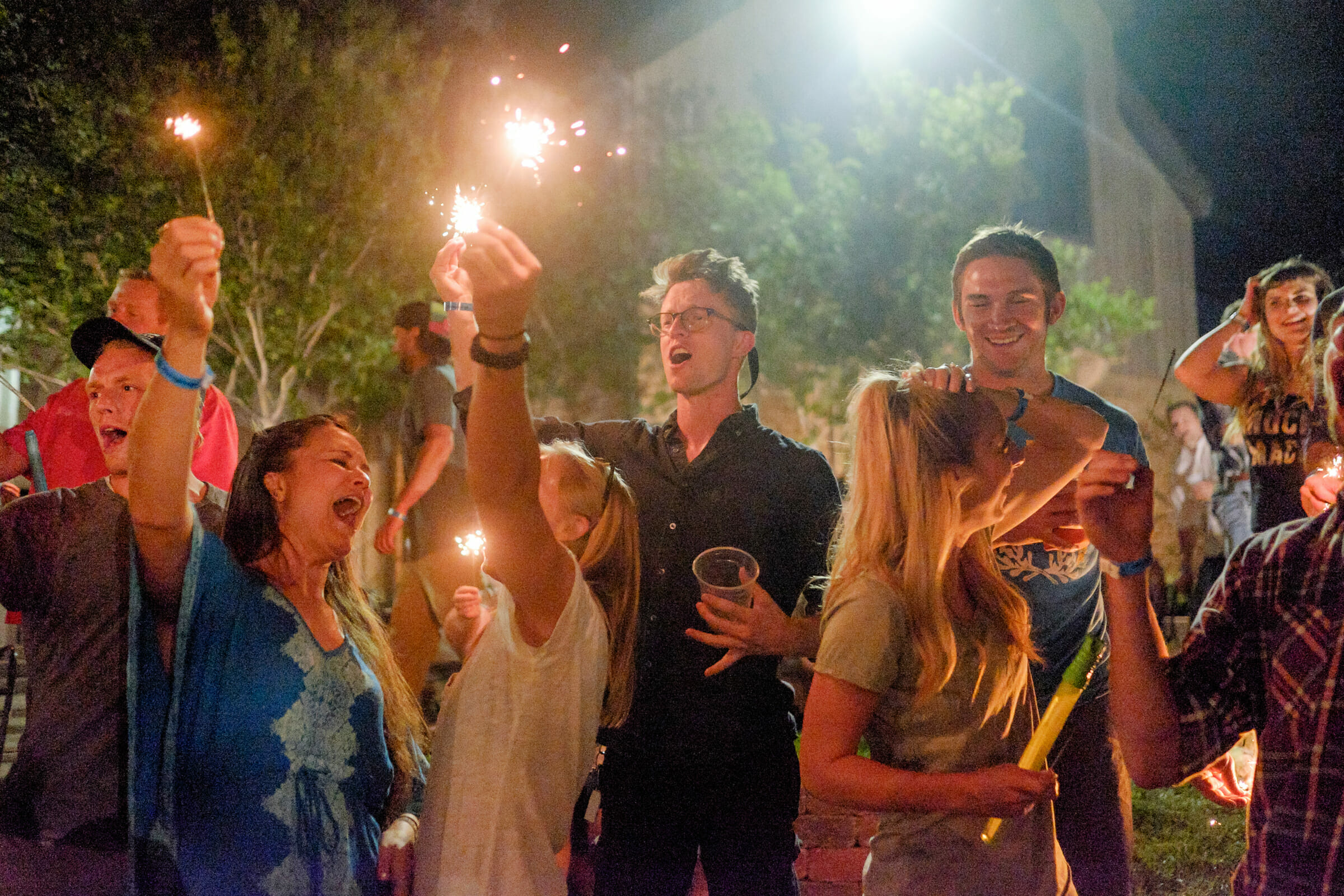 Group of people celebrating with sparklers