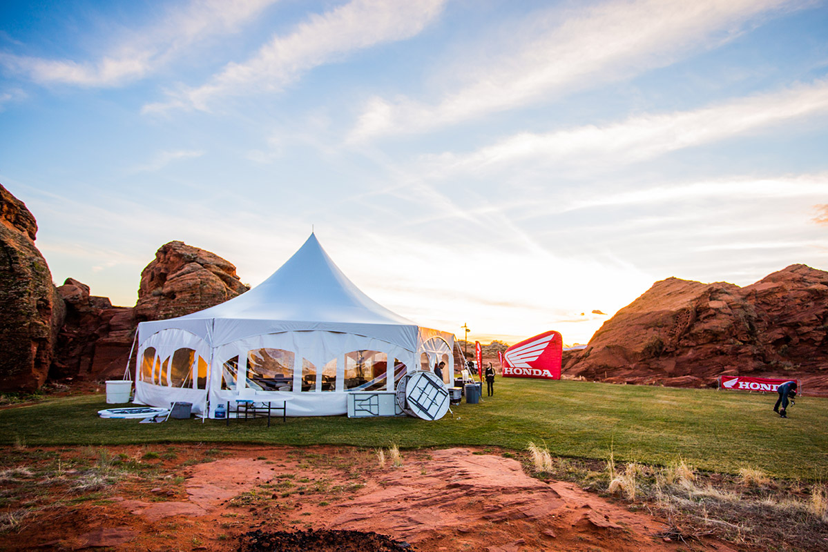 Outdoor event setup with large white tent