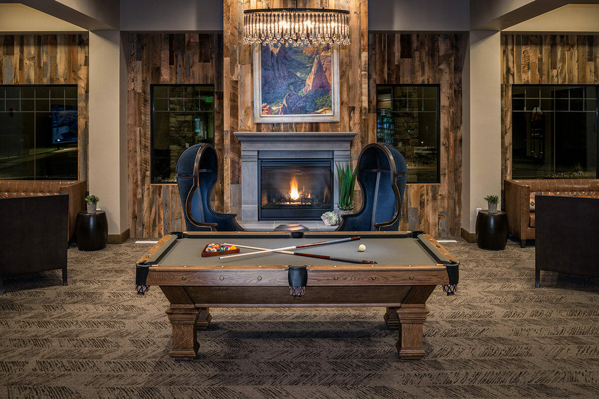 Pool table in large room with fireplace