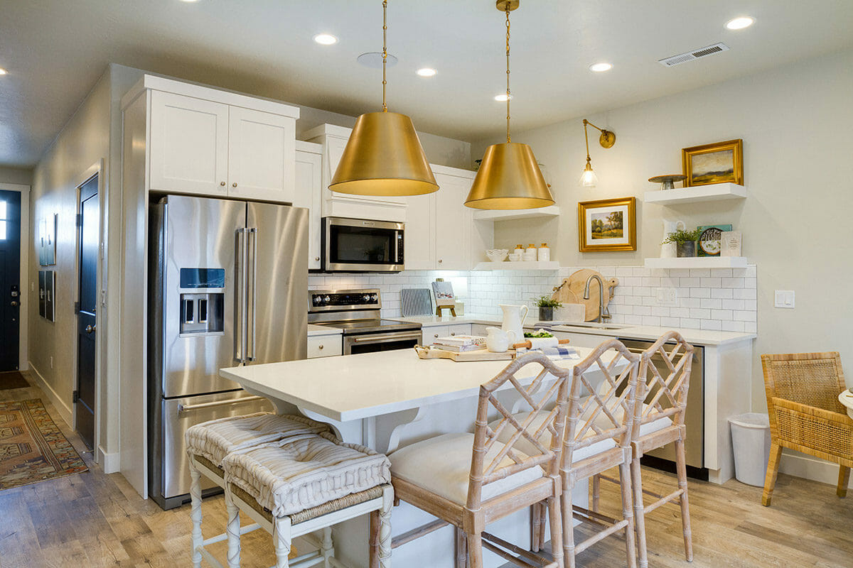 All-white kitchen with seating area