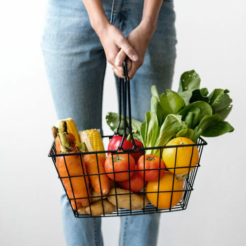 Woman holding a basket of fresh produce