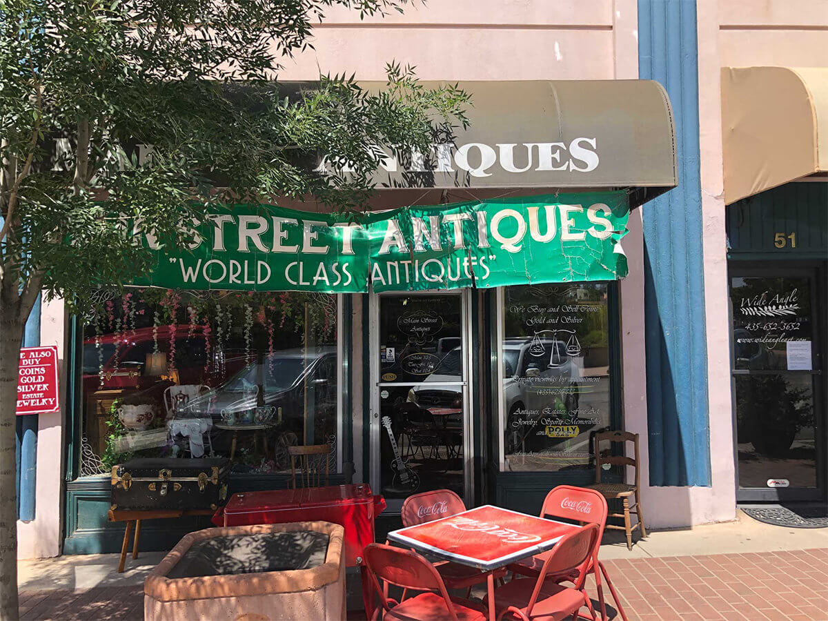 Antique storefront with green banner