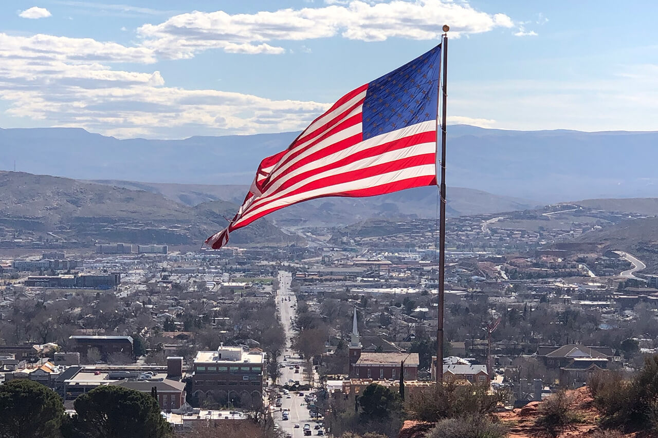 Flag of the United States over cityscape