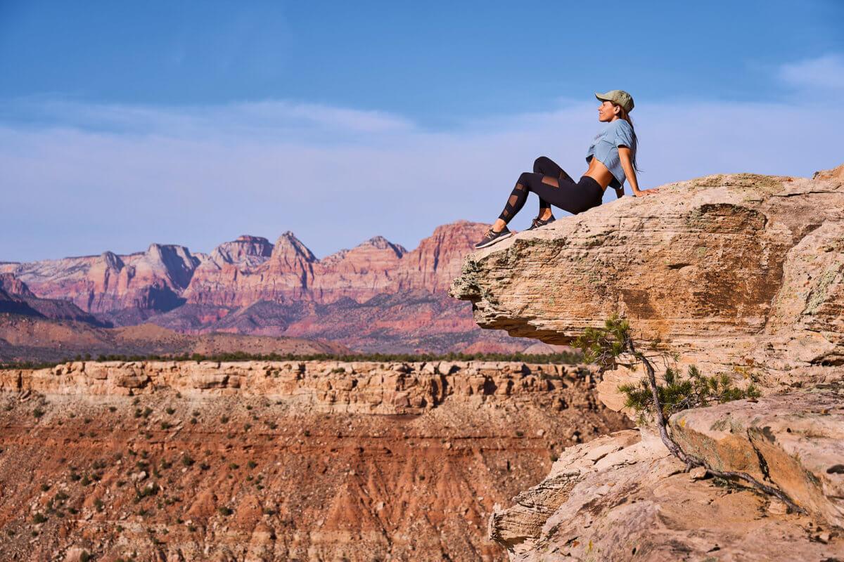 Woman sitting on cliff's edge