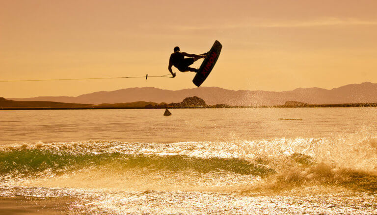 Airborne wakeboarder at sunset