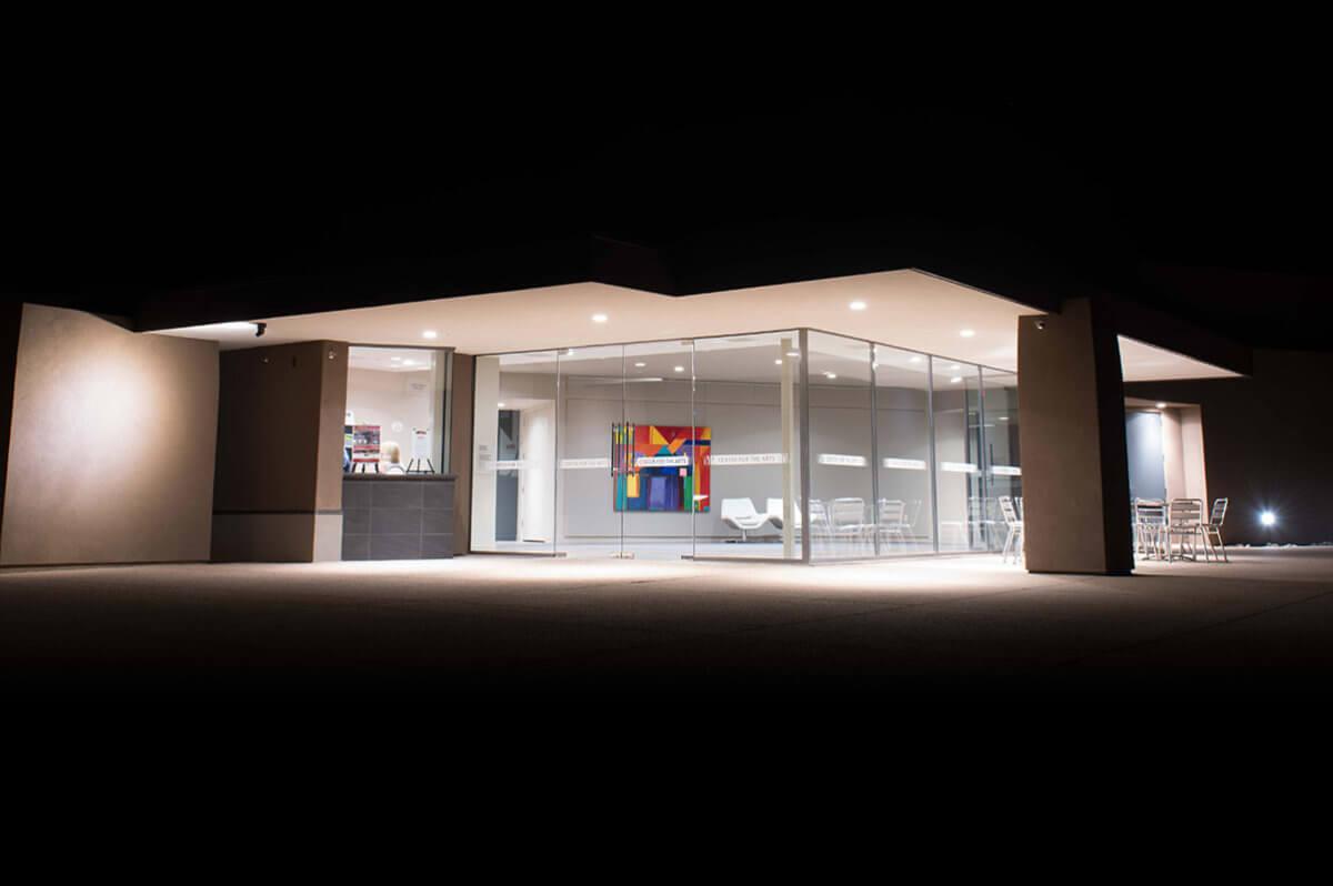 Modern building at night illuminated from inside