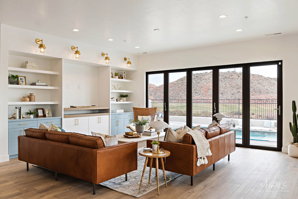 Bright, open living space with two brown leather couches