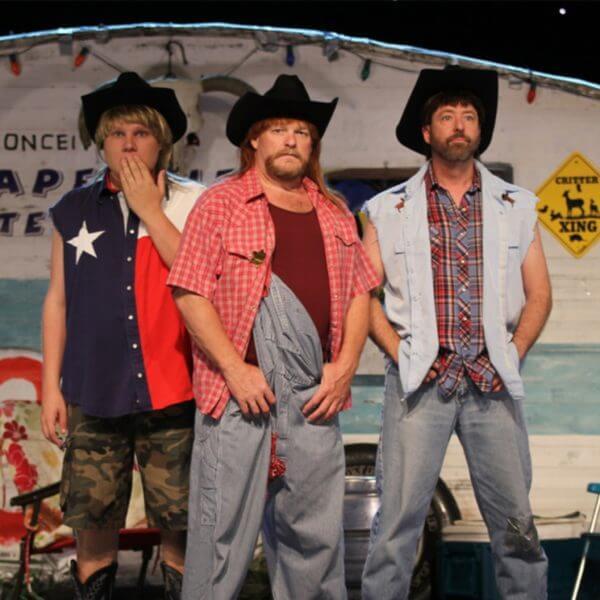 Three men dressed in