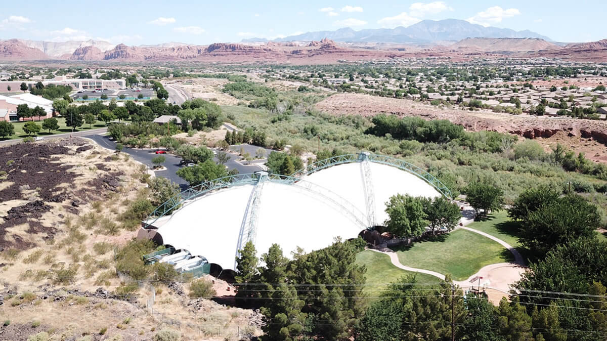 Aerial view of white tented building