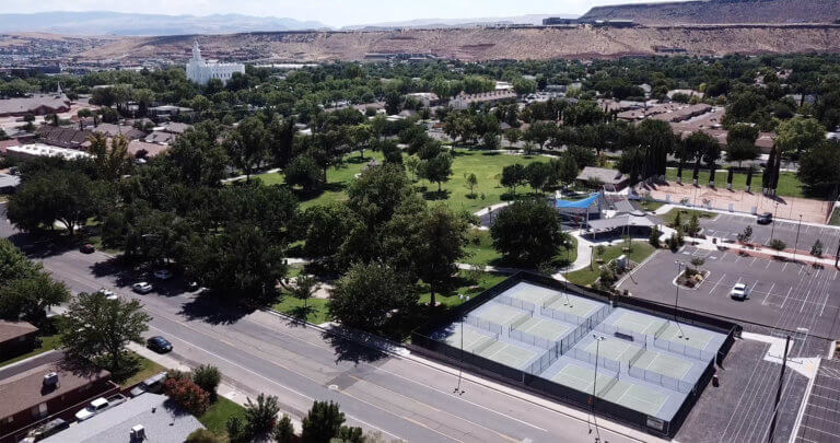 Aerial view of city park with pickleball courts