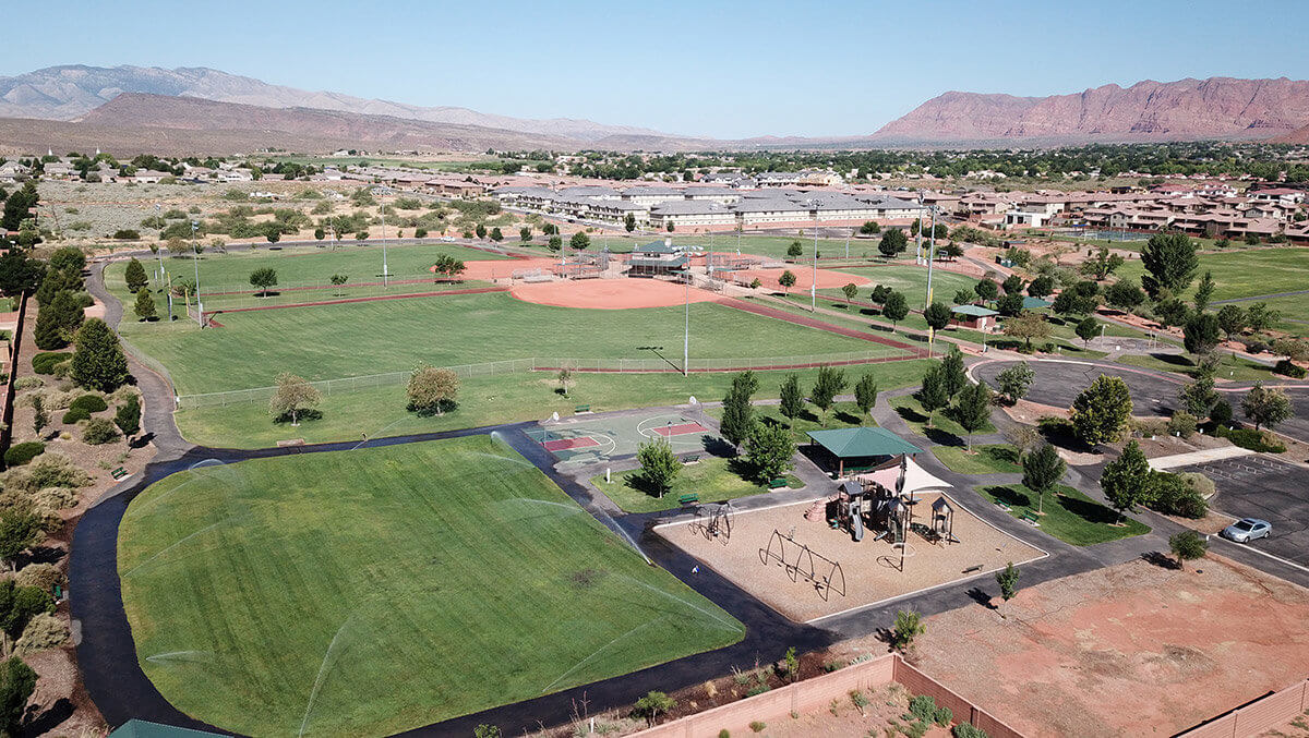 Aerial view of park with playground and softball complex