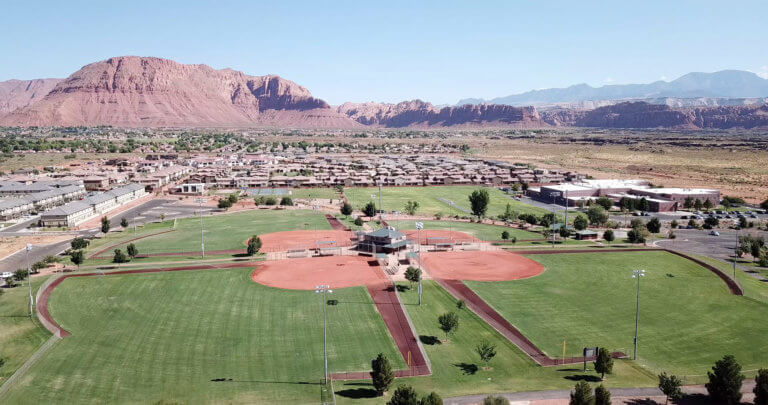 Aerial view of softball complex with mountains in background