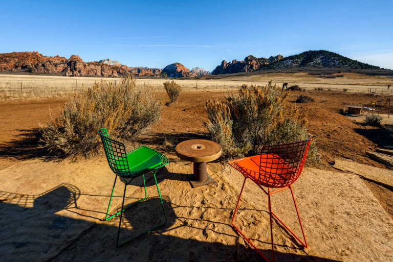 Orange and green chairs with mountain view