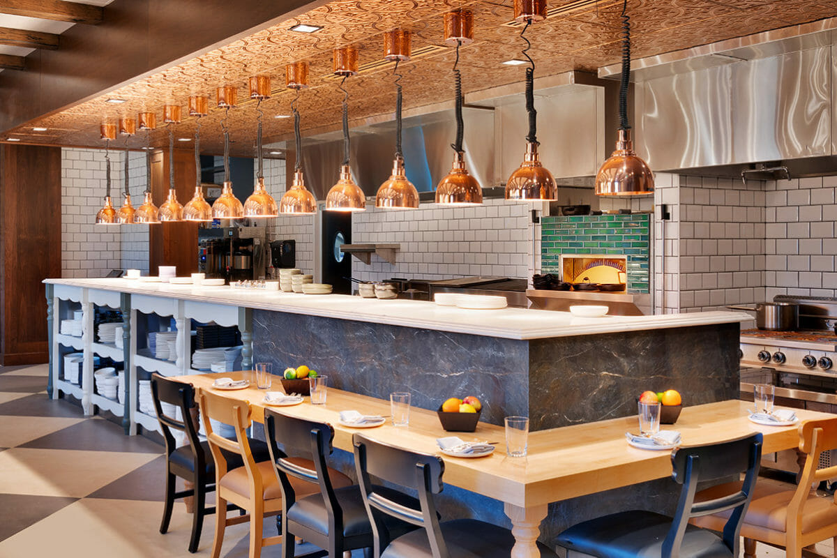 Diner-style counter in restaurant with copper heat lamps