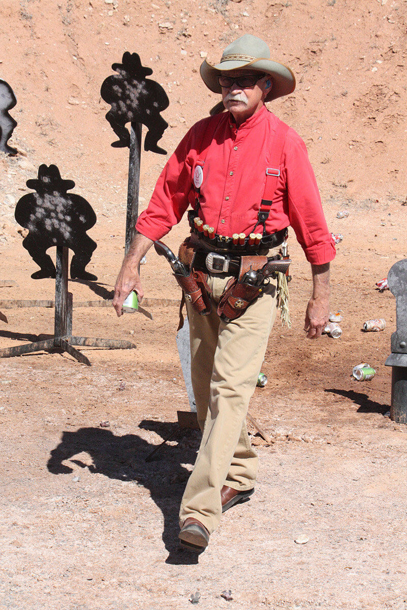 Man walking with holstered twin revolvers