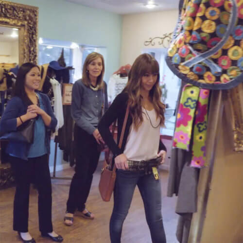 Three women shopping in clothing store