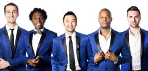 Five men in blue tuxedos