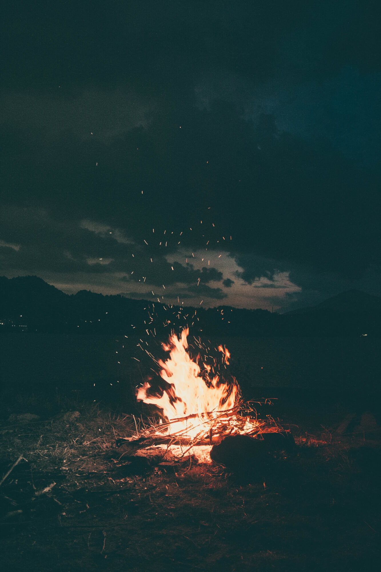 Mountain fire at night