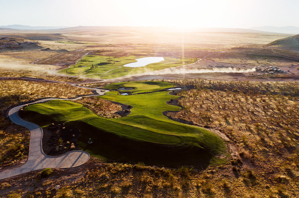 Aerial view of golf course at sunrise