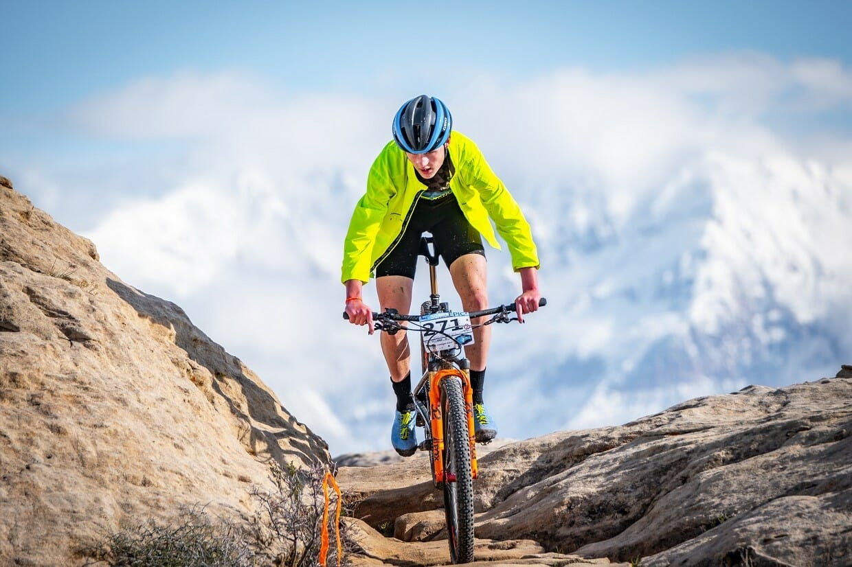 Person mountain biking on rocks