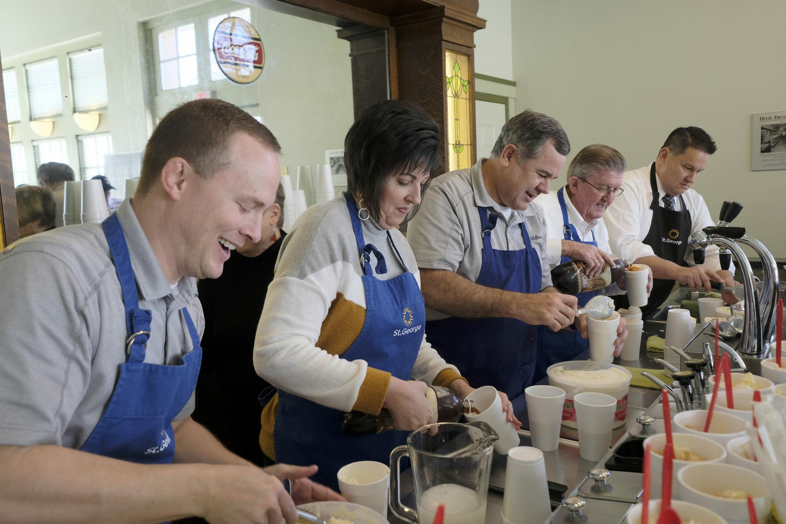 People serving ice cream