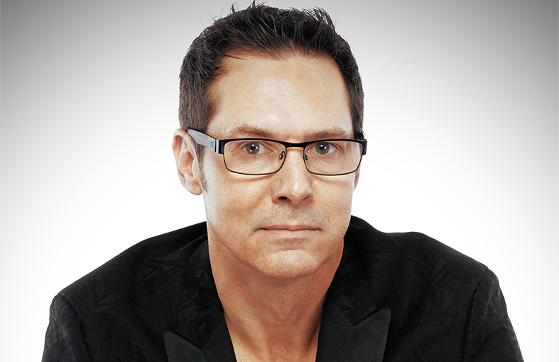 man with glasses in front of white background