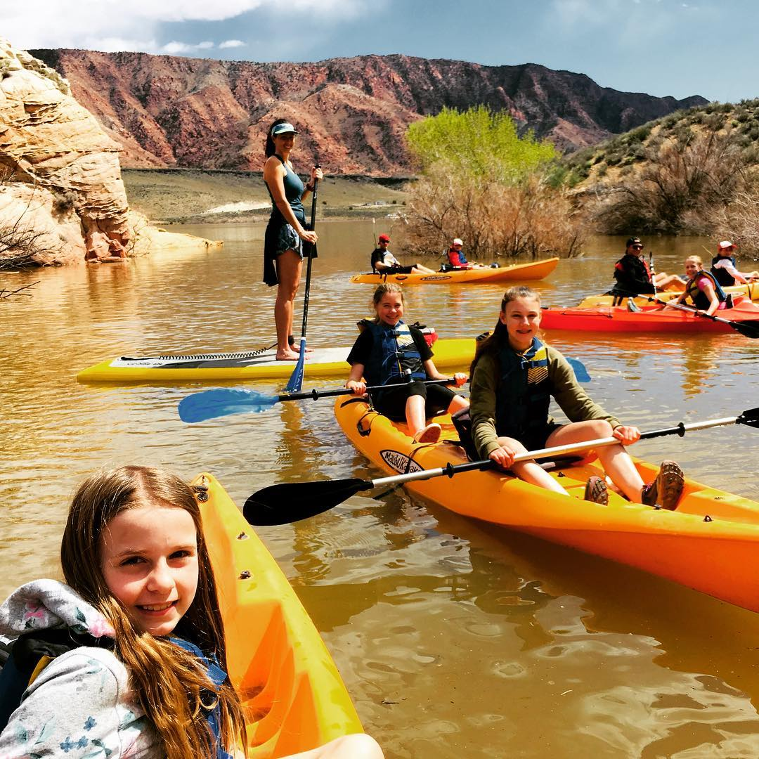 kids on colorful paddleboards, on water