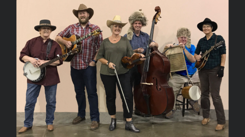 6 people standing with instruments