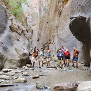People pointing at canyon walls