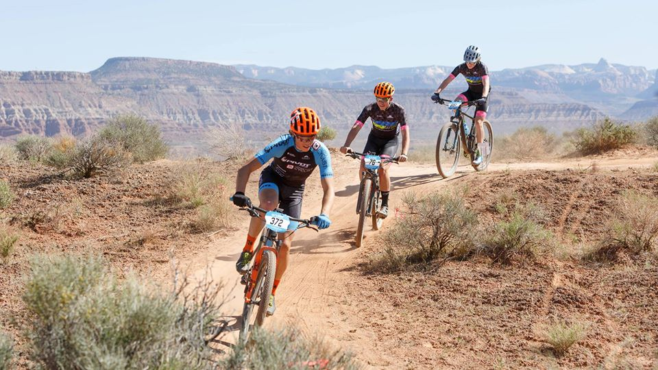 3 people riding bikes on dirt